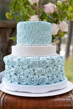 Pale duck egg baby blue roses piped tiered ivory wedding cake