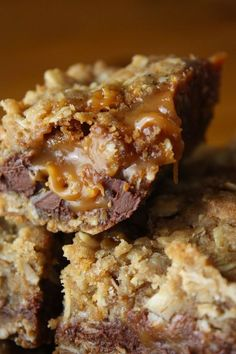 Carmelitas: 32 Caramel Squares, unwrapped, 1/2 cup Heavy Cream, 3/4 cup Butter, melted, 3/4 cup Brown Sugar, packed, 1 cup Flour, 1 cup Rolled Oats, 1 teaspoon Baking Soda, 6 ounces Semisweet Chocolate Chips. Ooey, Gooey Deliciousness!!