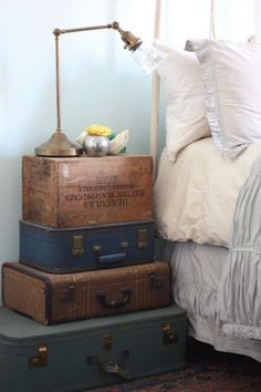 DIY Tip: Stack suitcases to create a quick and easy vintage nightstand. #bedroom #retro