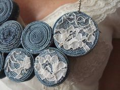Denim necklace with lace accent.