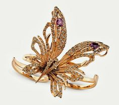 The butterfly from Damiani uses yellow gold accented by brown and white diamonds, and amethysts. Each butterfly is made with a variety of material combinations and can be worn as a pendant, brooch or set onto a ring.
