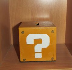New Super Mario Bros style question mark block handpainted wooden coin bank. $15.00, via Etsy.