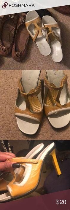 Gently worn Nine West Sandals Nine West golden yellow and cream sandals. Velcro adjustable strap. Heel is 4.5 inches Nine West Shoes Sandals