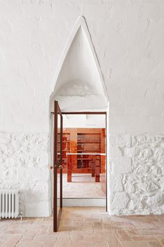 """""""Labyrinthine"""" country house in Spain revamped with whitewashed stone"""
