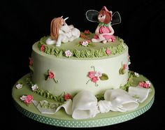 Fairy+Unicorn+Garden+Cake+-+For+a+4+yr+old's+birthday+cake....so+many+thanks+my+friends,+Aine2+for+her+superb+modeling+tutorial+found+on+her+website...and+her+personal+help,+Katharry+for+her+horse+instructions+and+motivation,+ShirleyW+for+her+gelatin+wing+help,+Franjmc+for+her+bow+tutorial+and+Liis+for+her+fairy+tutorial. Cake+is+choc+with+choc+SMBC+fillling,+vanilla+SMBC+icing..flowers+fondant..models+fondant/gumtex....bow+gumpaste Thanks+for+looking