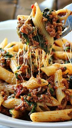 Slow Cooker Beef and Cheese #OnePotPasta ~ is cooked long and slow to bring out the best cheesy meat sauce!