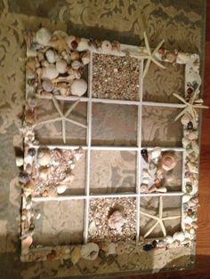Old window decorated with shells.