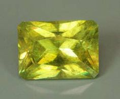 15965 Sphene,x Md Yellow, 5.23 cts emerald brilliant cut measuring 11.0x8.0x6.4 mm, lt incl, from Madagascar. A dispersive gem made more attractive by the unusual cutting pattern for a sphene. Priced at $60/carat or $313.80/gem  D&J Rare Gems - Gems Cut By Us for sale