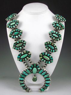 Squash Blossom Necklace | Ella Peter (Navajo).  Sterling silver and Carico Lake Turquoise
