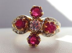 My superb ring with 4 natural rubies and 17 diamonds on 18 kt yellow and white gold
