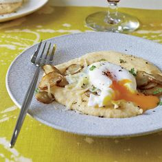 Home cooks can pair baked eggs with cheese polenta, evoking Bouley's Comté foam with polenta puree.