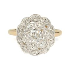 Antique 1920's White & Yellow Gold Diamond Ring by SITFineJewelry, $6300.00  It's a ring kind of a day.