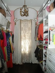 Pink-walled and chandelier-bedecked closet belonging to Chicago blogger Bailey McCarthy #closet #decor #organization