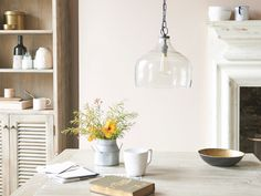 A pretty hanging pendant light with lovely bubbling in the glass... It's made us see cowbells in a whole new light.