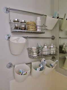 Bathroom organization using Ikea Bygel rail system.