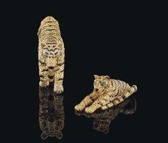 Broches Tigers de Cartier Christie's Geneva http://www.vogue.fr/joaillerie/a-voir/diaporama/la-vente-aux-encheres-de-bijoux-magnificent-jewels-2014-de-christie-s-geneve/21005/image/1110315#!broches-tigers-de-cartier-christie-039-s-geneva