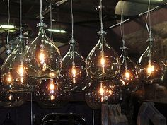 I recently discovered recycled glass bottles being repurposed into industrial lighting. I think you will find these hanging recycled glass bottles really cool. Edison Bulb Light Fixtures, Cool Light Fixtures, Industrial Style Lighting, Cool Lighting, Lighting Ideas, Edison Lighting, Industrial Design, Lighting Design, Cool Hanging Lights