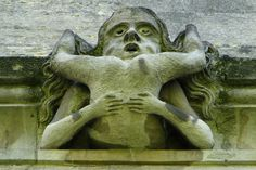 ancient gargoyle from Magdalen College, Oxford.  a contortionist? or 2 bodies? were the architects warning the students against this behaviour? or implying that Oxford students often did this?