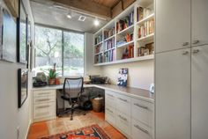 Small Home Office Wall Bookshelf Decor with White Cabinets and Glass Window Design Ideas