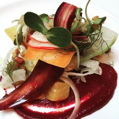 A stunning roasted beet purée, with crunchy peanuts and shaved root veggies. A really fun restaurant.