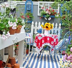 Love how the fence appears to be walls with window boxes ~