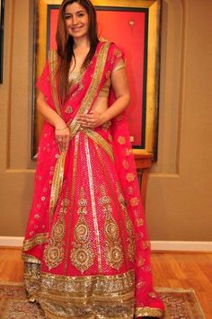 If you love pink, this a great lehenga to go for - maybe with smaller or no paisleys (it's a bit overdone these days) : by Sabyasachi Mukherjee