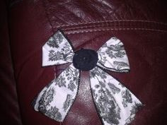 $5.00 Bow with rolled rose, with your choice of clip or headband Come over to www.facebook.com/... and check us out. message for pricing and info!