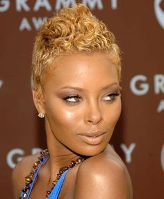 Eva Marcille is so daring and fierce with her super short and blonde hair, looking like a diva.