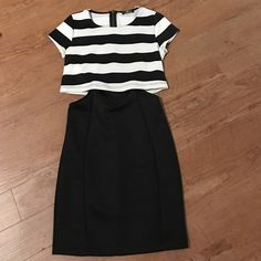 Cute Dress with cutouts Black and white striped loose fitting top part of the dress, with cut outs on the sides and a tight fitting all black bottom portion. Very in style right now! New without tags Dresses Mini
