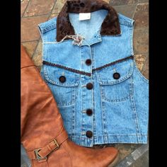 Fun Embellished Denim Vest Denim vest embellished with brown buttons, material and ribbon to create a fun look. Great preloved condition. NO spots or damage. Jackets & Coats Vests
