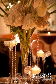 #wedding reception decorations #centerpieces #tablescapes #reception details #Michigan wedding #Mike Staff Productions #wedding details #wedding photography http://www.mikestaff.com/services/photography #white flowers #candles #tall centerpieces