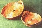 Learn how to weave a pine needle basket, includes how to prepare needles, adding thread when weaving, forming the basket side walls and basket stitching.