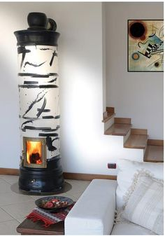 La Castellamonte: Italian artistic stoves are so beautiful and I want one.