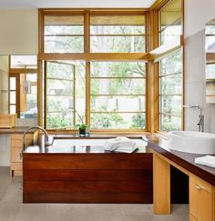 Luxurious use of wood with a nice open leafy view, which makes it so spacious yet still private