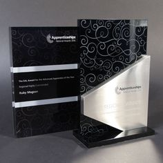 Eye-catching glossy black acrylic and brushed aluminium award with intricately printed silver detail. Each award is personalised by printing of logo and winners' details directly onto the brushed aluminium layer. If you have any questions or would like to discuss ideas for your next event, please email award@efx.co.uk or call 01789 450005 for your FREE … Trophies And Medals, Custom Trophies, Glass Awards, Trophy Design, Stage Set Design, Environmental Graphic Design, Metal Plaque, Signage Design, Wall Plaques