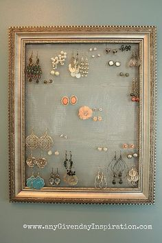 Idea - mesh in frame, buttons or door accessories along bottom to hold necklaces (stud earrings ? )