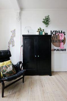Love the black cupboard. Monochrome.