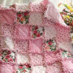 """Baby Rag Quilt Dreamy Rose  Sweet prints of roses in pinks and reds create a beautiful quilt for your baby girl. Imagine the delightful time you will spend as a new mom cuddling your sweet baby. Nursing, singing, reading and just because. Snuggle time will be extra special with a handcrafted quilt that will be cherished for years to come. Measures approx. 35 x 35""""  $154.00"""