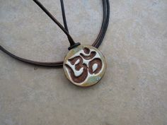 Your place to buy and sell all things handmade Essential Oil Diffuser, Essential Oils, Om Necklace, Om Pendant, Aromatherapy Jewelry, Perfume And Cologne, Ceramic Bisque, Earthenware Clay, Diffuser Necklace