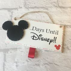 Counting down to a trip to Disney? This handmade wooden plaque is a perfect visual countdown to be hung up anywhere. Comes ready with chalk, to store in the ribbon loop. The plaque comes as standard with red little Mickey Mouse in the bottom corner, red ribbon loop and red border. Please state if you would like a different colour. Plaque measures 6x3 inches *Due to all my items being handmade - orders currently take up to 10 working days, please keep this in mind whilst ordering. If however…