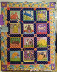 """Cats Rule"" by Kathy Mack, quilted by Shannon Freeman.  Folk Art Cats design by John Simpkins (pattern available). 2014 RCQG, photo by Quilt Inspiration"