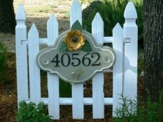 House number display idea - for that little 'dead' spot under the tree by the driveway. Our house numbers are almost impossible to read!