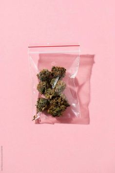 some marijuana buds in a plastic bag on a pink background Cannabis Wallpaper, Weed Wallpaper, Aesthetic Iphone Wallpaper, Aesthetic Wallpapers, Medical Marijuana, Thc Oil, Wallpeper Tumblr, Stoner Girl, Dope Wallpapers