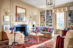 For the oldest house in Washington, D.C., designer devises Mariette Himes Gomez devised elegantly edited decor that enlivens the home's Georgian architecture. Dominated by paneling painted in a Donald Kaufman hue that recalls Wedgwood drabware, the library's neutral color scheme is warmed by the ruddy tones of a carpet from Doris Leslie Blau and Fortuny-fabric pillows from David Duncan.