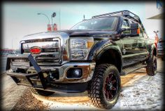 "SOLD!!  Lifted 2014 #FORD  #F350 Lariat ""Black Widow"" edition #SuperDuty #PickUp #truck.   Contact us for more info or to purchase.  - Modifications include:   - 6"" ProComp Lift & 20"" DPR Wheels & MT2 Tires   - Painted Flares   - Power coated suspension parts   - Custom Sprayliner in red  - Ventshades   - Bug Deflector   - Spyder bull bar and light  - Black window decals   - Box tire rack and light   - Lighted F-350 name plates   - Tinted windows and T/L"