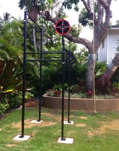 Solid outdoor Rogue rig - love the height on the backside #backyardgym