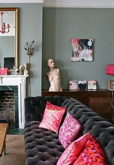 loving this sofa... I'd have gone with red pillows, or turquoise, with silver/blue walls