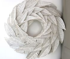 book leaf wreath (I could only do this if the book was already damaged, because I hate the idea of cutting up book pages... maybe with a newspaper instead...?)