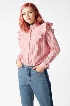 Why settle for a boring button up shirt when you can have this one with a bit of extra ruffle to jazz it up?