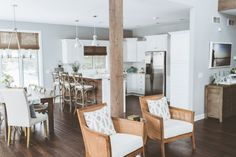 Open plan kitchen in white with wood accents